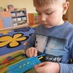 Lašiukas - autistiškų vaikų simbolio dalis